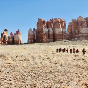 women backpacking together